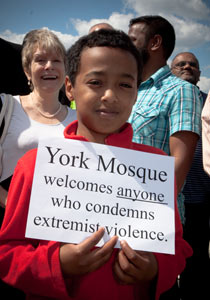 A young member of York mosque displays his message. Photograph: Ann Czernik